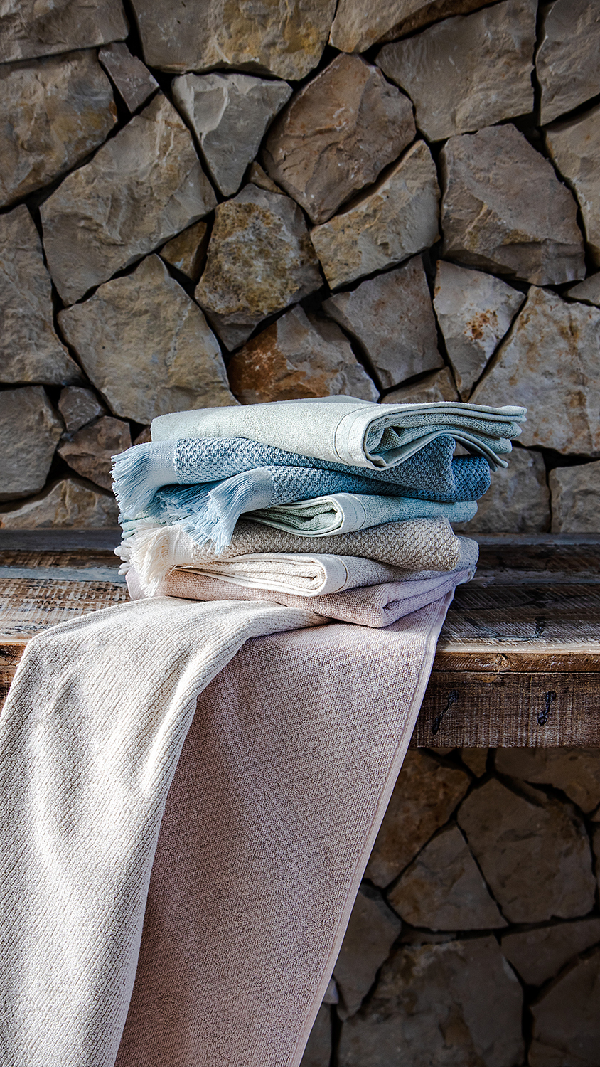 Stack of folded towels in bathroom