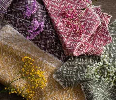 Pink, purple, yellow and green woven fabrics with matching flowers