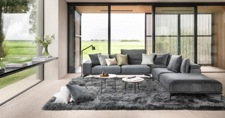 a grey sofa by Symphony Mills in a spacious living room